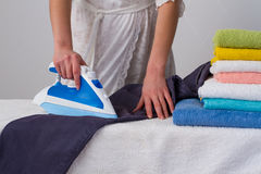 Ironing trousers Royalty Free Stock Photography