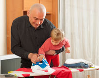 Ironing underwear in family Royalty Free Stock Images