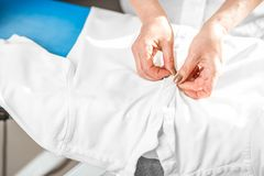 Ironing a white shirt on the board Royalty Free Stock Photography