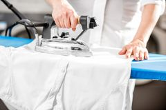 Professional ironing in the laundry Stock Image