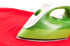 Ironing a wrinkled red shirt Stock Image