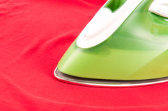 Ironing a wrinkled red shirt Stock Photography