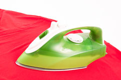 Ironing a wrinkled red shirt Stock Photos