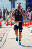 Ironman 2012 triathlete running royalty free stock photography