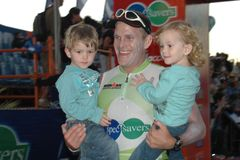 Ironman runner. Father posing with his children after the ironman south africa event at hobie beach Stock Image