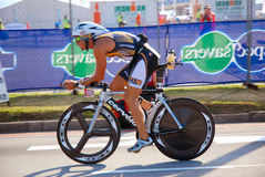 Ironman triathlete cycling bike royalty free stock image