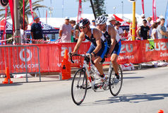 Ironman triathletes cycling on tandem Royalty Free Stock Photo