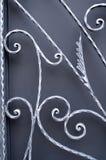 Ironwork изогнутый серым цветом нанесённый стоковая фотография