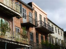 Ironwork Balconies. Fancy ironwork railings on balconies on old buildings in the French Quarter , New Orleans Louisiana Stock Photos