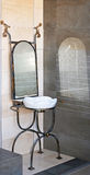 Ironwork basin. Self standing basin with mirror in ironwork stock images