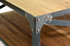 Ironwork corner with rivets. Fixing for a table. Close-up stock photography