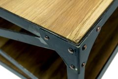 Ironwork corner with rivets. Fixing for a table. Close-up stock photo