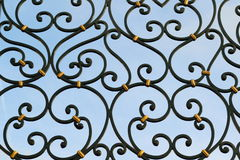 Ironwork. Detail of beautiful ironwork gate painted in black stock images