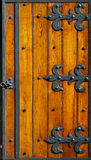 Ironwork hinges. Very old ironwork hinges at wooden blinds stock photos
