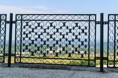 Ironwork metal fence - detail of beautiful decorative manual forged metal fence.  stock images