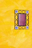 Ironwork mirror. Old ironwork frame mirror at yellow wall royalty free stock photography