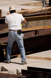 Ironworker. A construction worker handling an iron beam royalty free stock photography