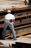 Ironworker. A construction worker handling an iron beam royalty free stock photos