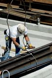 Ironworker. A construction worker hooking up iron beams royalty free stock images