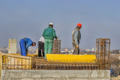Ironworkers install reinforcing steel for concrete slab 2 Stock Photos