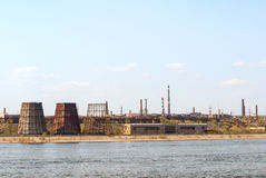 Ironworks on river coastline Stock Photos