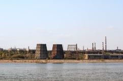 Ironworks on river coastline Stock Images
