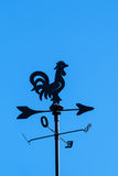Irony weather cock on a  blue sky background. Black irony weather cock on a  blue sky background Stock Photo