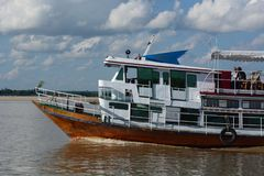 Cruising on Irrawaddy river. Myanmar. The Irrawaddy River or Ayeyarwady River is a river that flows from north to south through Myanmar, the country`s largest Royalty Free Stock Photo