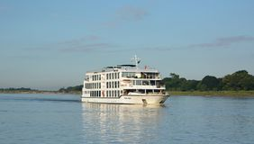 Cruising on Irrawaddy river. Myanmar. The Irrawaddy River or Ayeyarwady River is a river that flows from north to south through Myanmar, the country`s largest Royalty Free Stock Photos
