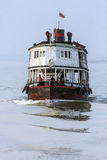 Irrawaddy River - Myanmar (Burma). An old riverboat at sunrise on the Irrawaddy River (Ayeyarwaddy River) in Myanmar (Burma).  It is the countrys largest river Stock Photos
