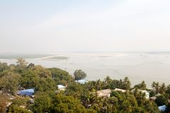 Irrawaddy river Myanmar. Irrawaddy river landscape at Mingun, Myanmar. The Irrawaddy river flows from North to South through Burma. It is the country's largest Stock Photo