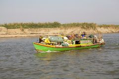 Irrawaddy river Myanmar. Traditional burmese boat is carrying goods on the Irrawaddy river at Mandalay, Myanmar. The Irrawaddy river flows from North to South Royalty Free Stock Image