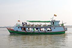 Irrawaddy river Myanmar. Traditional burmese boat is carrying tourist from mandaly to Mingun on the Irrawaddy river, Myanmar. The Irrawaddy river flows from Royalty Free Stock Images
