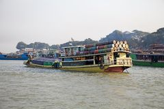 Irrawaddy river Myanmar. Traditional burmese boats is carrying goods on the Irrawaddy river at Mandalay, Myanmar. The Irrawaddy river flows from North to South Stock Photography