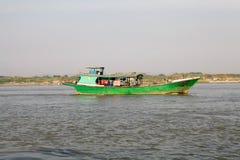 Irrawaddy river Myanmar. Traditional burmese boats on the Irrawaddy river at Mandalay, Myanmar. The Irrawaddy river flows from North to South through Burma. It Stock Photos