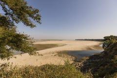 Irrawaddy River with sandbar in Bagan, Myanmar. Irrawaddy River with tree and sandbar in Bagan, Myanmar Royalty Free Stock Image
