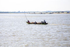 IRRAWADY RIVER, MYANMAR - November 17, 2015: Transporting pigs o Royalty Free Stock Image