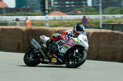 IRRC Motorcycle race in Ostend Belgium. Local hero Timothy sparky Baken from Team Mototech,leaning with his Honda CBR in the final turn of the circuit Royalty Free Stock Images