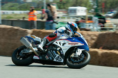 IRRC Motorcycle race in Ostend Belgium. Sebastien LeGrelle from Team Herpigny Motors ,leaning with his BMW S1000RR in the final turn of the circuit Royalty Free Stock Photos