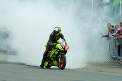 IRRC Supersport race in Ostend Belgium. Denis Sanchez showing off some of his burnout skills at the end of the IRRC Supersport race Royalty Free Stock Photography