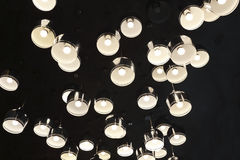 Irregular arrangement of aluminum cover LED lights. Under the ceiling, down many round aluminum cover LED lights royalty free stock photography