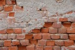 Irregular brick wall. Irregular red ancient brick wall royalty free stock photos