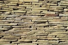 Irregular brick wall with various tint and forms of brick. Stylish stone wall background.  royalty free stock photos