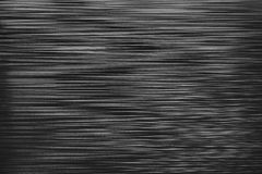 Irregular horizontal lines background. Black and white plastic texture Stock Image