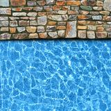 Irregular pavement with pool edge Stock Photo