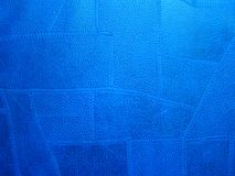 Stitched leather texture. Irregular shaped pieces of leather stitched together and colored blue. Texture or background, or wallpaper Royalty Free Stock Photography