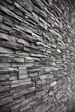 Irregular shaped stone wall with different levels. Large irregular shaped brick wall in grey Stock Photos