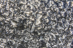 Irregular shiny silver texture. Background Stock Photography