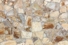 Irregular stone wall. Wall of different types of irregular shaped stones Stock Photo