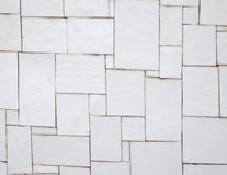 Irregular white tiles on a wall. Used as background Royalty Free Stock Photography